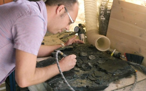 Amateur paleontologist spends two years gluing giant plesiosaur fossil back together after smashing it