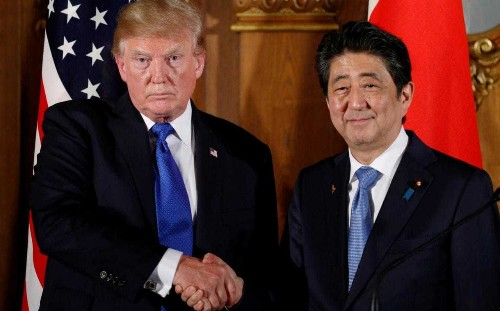 Japan's Shinzo Abe under pressure to resign as he prepares for critical two-day summit with Donald Trump