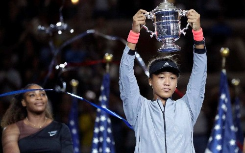 Naomi Osaka receives US Open trophy in tears after boos greet presentation ceremony