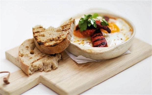Caravan's baked eggs and chorizo with tomato ragout recipe