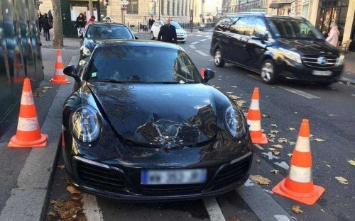Man leaves Porsche in taxi rank to go to a Paris nightclub and returns to find bomb squad has blown its bonnet off
