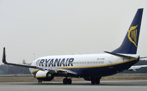 Ryanair halves excess baggage fee