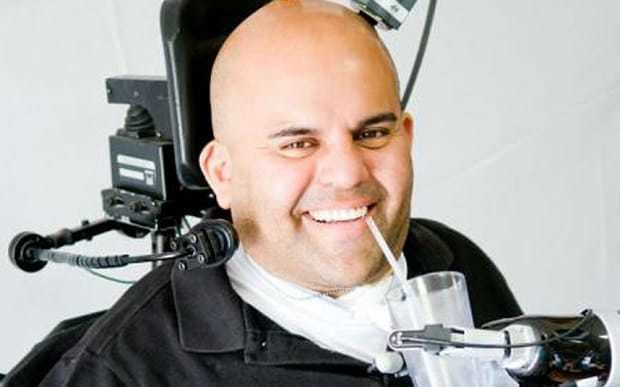 Brain implants let man control robotic arm with thoughts