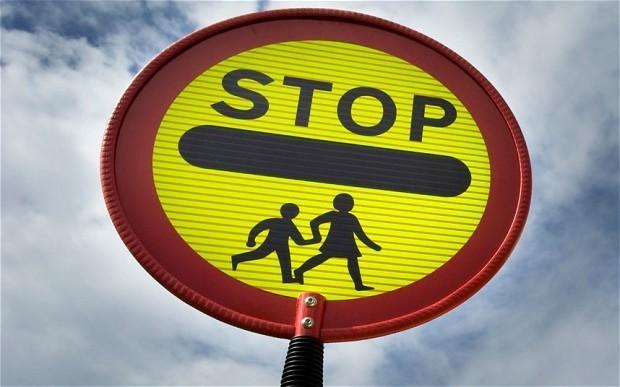 Lollipop man resigns after being warned over high-fiving children