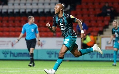 Swansea City go top of the Championship thanks to Andre Ayew's second-half winner at Charlton