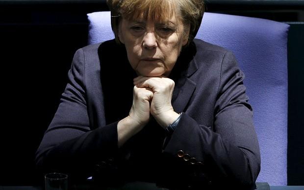 Greek government on its 'last legs' while Angela Merkel faces growing rebellion in Berlin