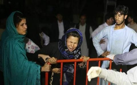 Suicide-bomb rips through wedding blast in Kabul as dozens feared dead