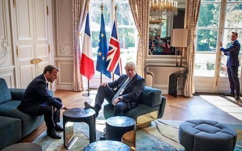 Macho Macron tried to boss Boris Johnson... but the bumbling bulldog fought back