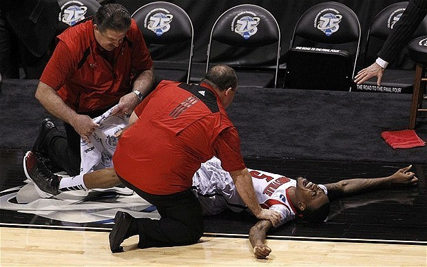 March madness: Kevin Ware's public agony highlights lure of basketball's NCAA