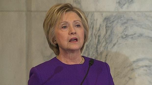 Hillary Clinton warns of danger of fake news as she addresses ceremony for Harry Reid