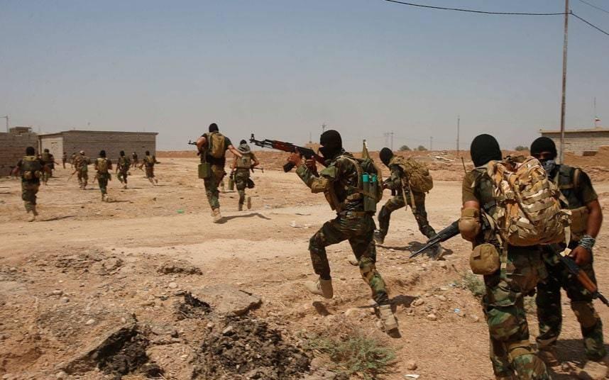 Iran-backed Shia militia says it will fight US Marines deployed to Iraq