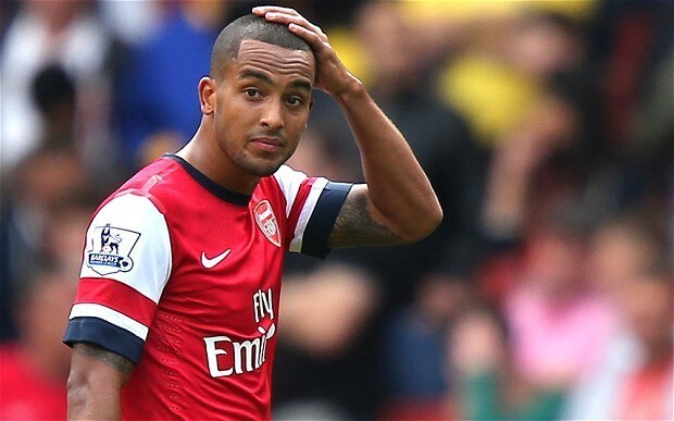 Arsenal winger Theo Walcott out of the World Cup after rupturing knee ligament in defeat of Tottenham Hotspur
