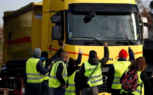 French fuel protests block roads for third day amid injuries and racist attacks