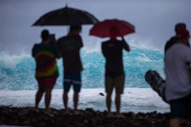 Hawaii is hit by wind and rain in first wave of rare double hurricane