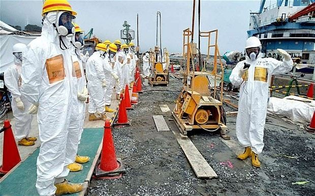 Fukushima workers doused in highly radioactive water