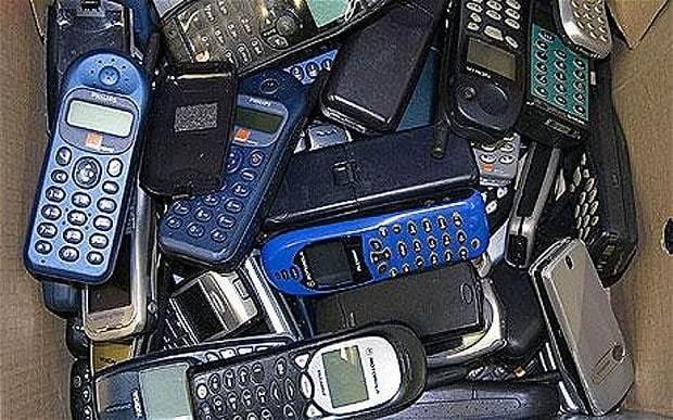 Mobile phone graveyard opens its digital gates