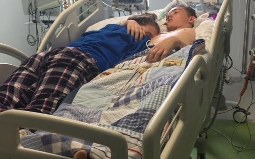 Heartbreaking picture of girl cuddling her boyfriend in hospital before his life support machine is switched off
