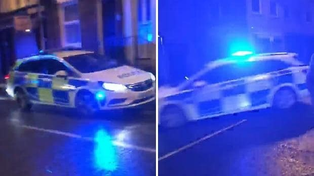 Police car makes astonishing sliding handbrake turn as it arrives at scene of brawl