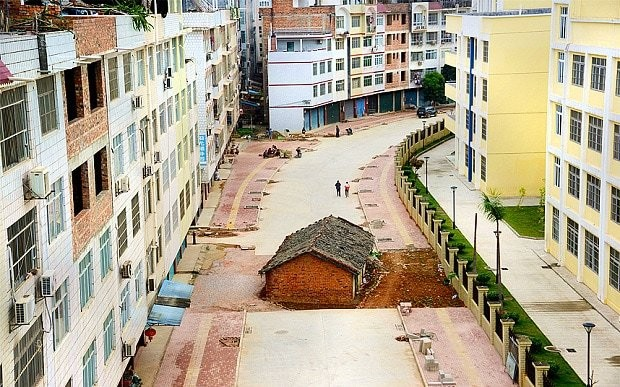 Stubborn Chinese home owners refuse to let 'nail house' be demolished