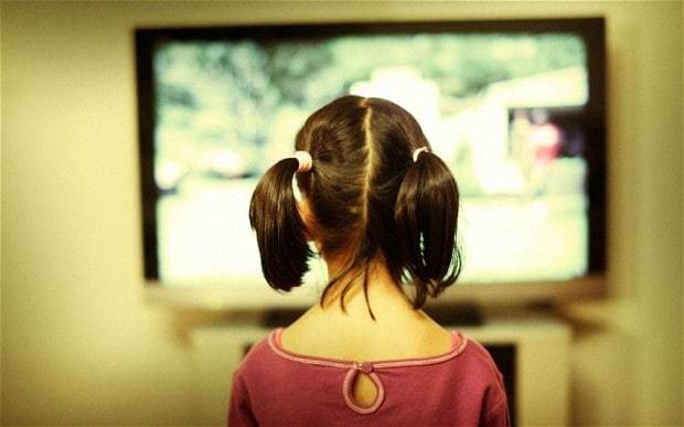 Letting children watch hours of TV improves academic ability, study claims