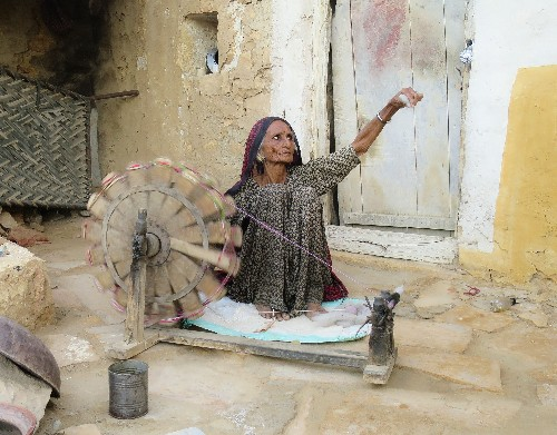 Timeless image of woman spinning yarn in India wins Big Picture photography competition