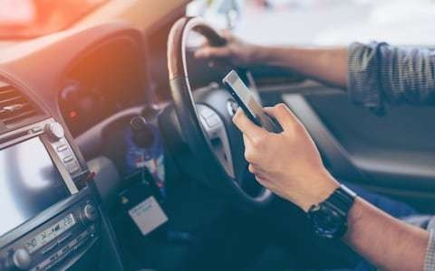 Motorists could challenge convictions for driving while using their phones after man has case overturned