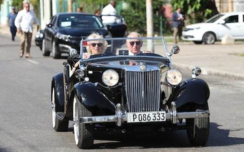 Prince Charles and Camilla tour the streets of Havana in a vintage MG TD