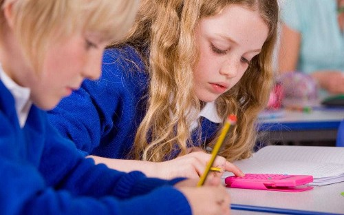 Children struggle to hold pens because of excessive use of iPads, claim experts