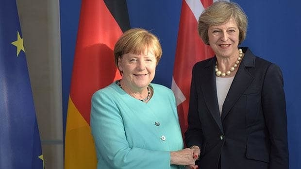 Angela Merkel says the UK is right to pause before triggering formal Brexit talks in a boost for Theresa May