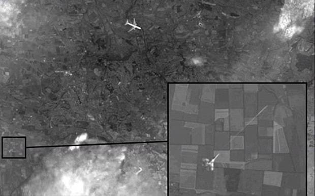 Russia says MH17 was shot down by plane missiles