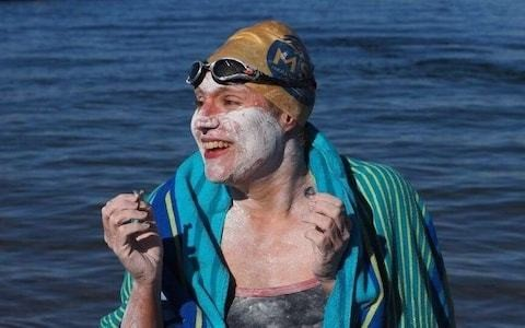 Cancer survivor becomes first to swim Channel four times non-stop