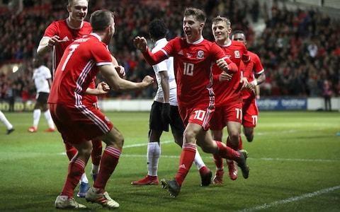 Ben Woodburn strikes late to give makeshift Wales win over Trinidad & Tobago