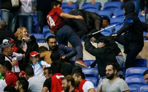 Disgraceful scenes in Lyon as shocking fan violence delays Europa League clash against Besiktas