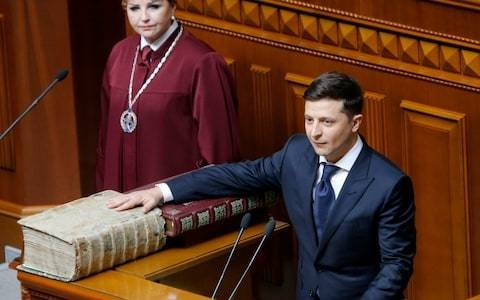 Ukraine's Zelenskiy to call early elections as he disbands parliament in first act as president