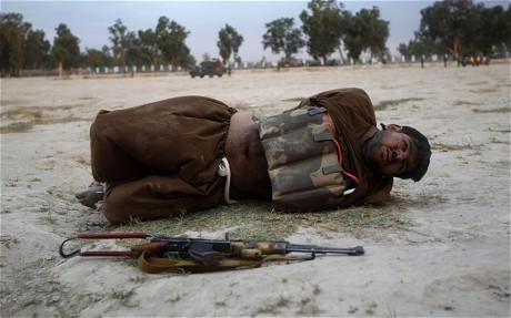 Afghan soldier defuses suicide bomber's vest