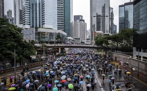 Hundreds of thousands defy military warnings to protest in Hong Kong