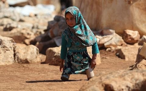 Syrian girl pictured using tin cans as prosthetic legs finds hope in Turkey