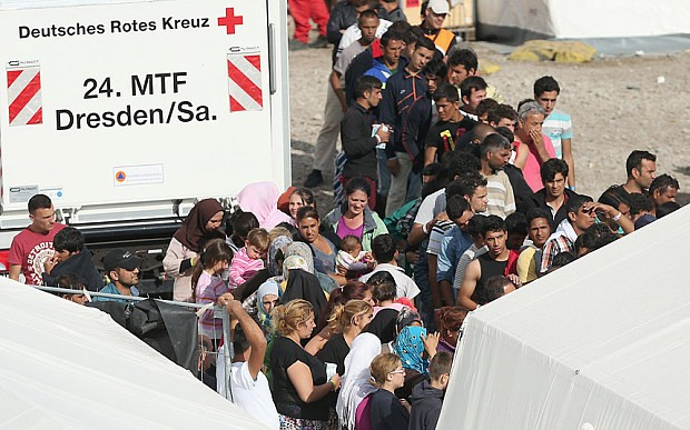 Germany drops EU rules to allow in Syrian refugees