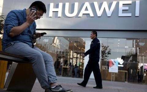 China accuses US of plot to 'colonise global business' by targeting Huawei