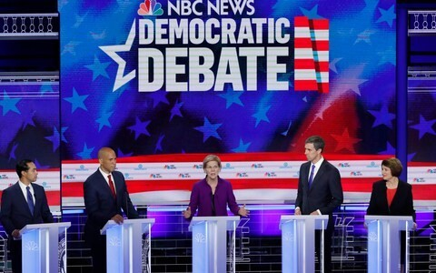 Democrat White House hopefuls clash on immigration and healthcare in feisty first campaign debate
