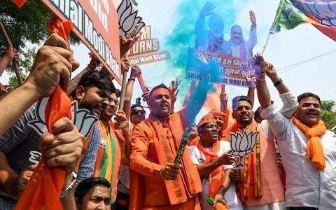 Narendra Modi wins surprise landslide victory in Indian election