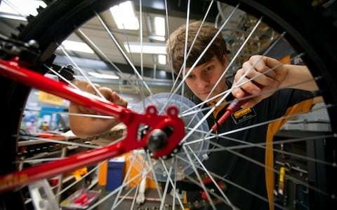 Halfords puts the brakes on investment as weather hits profits