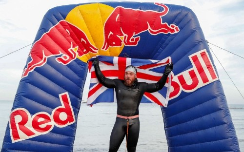 Adventurer becomes first man to swim around the British isles as he reveals singing got him through the challenge