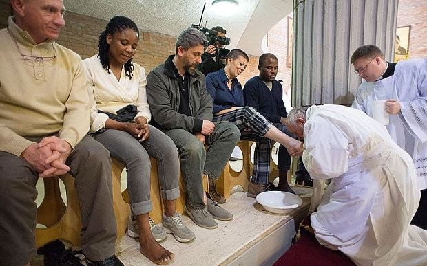 Pope Francis washes the feet of TV showgirl who was jailed for fraud
