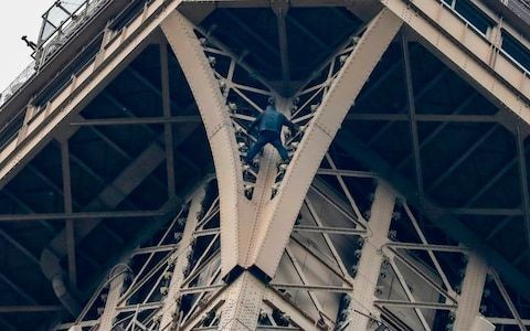 Eiffel Tower closed after climber scales monument