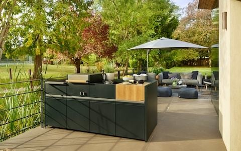 Forget four ovens - the ultimate status symbol is an outdoor kitchen