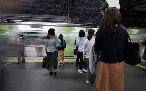 App that allows passengers to silently raise alarm over train groping becomes big hit in Japan