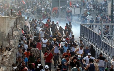 Iraqi troops use live fire as Baghdad erupts in protest