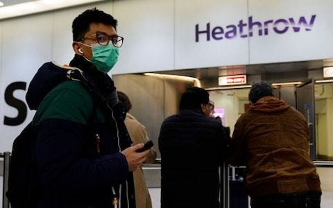 Coronavirus: hunt for 2,000 travellers who flew from Wuhan to Britain in last fortnight