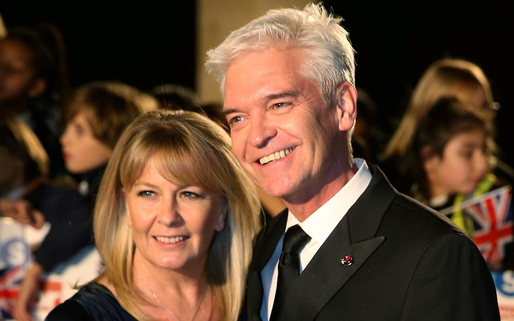 Like Phillip Schofield, my husband of 30 years came out as gay - and I won't ever recover